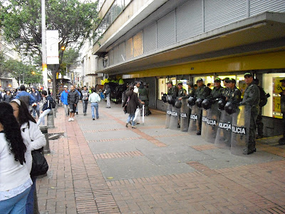 Riot police outside an Éxito supermarket in Bogotá during a peaceful rally in the city recently