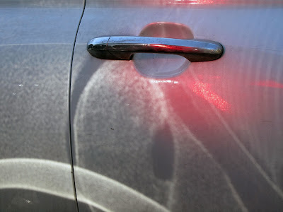 reflection of light in a silver car