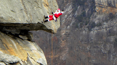 Santa climbs Chimney Rock