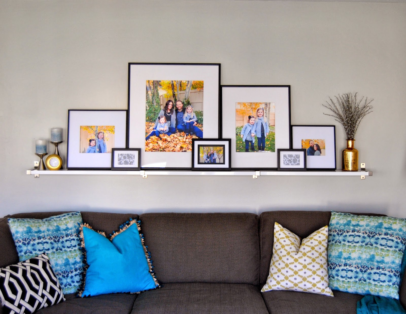 turquoise, gray paint, white shelf, black and white, gallery wall, silver and gold, sectional, custom pillows, diy, low cost decorating, studio 7 interior design, interior design, interiors, interior designer, salt lake city, utah, ikea, aloof gray, sherwin williams