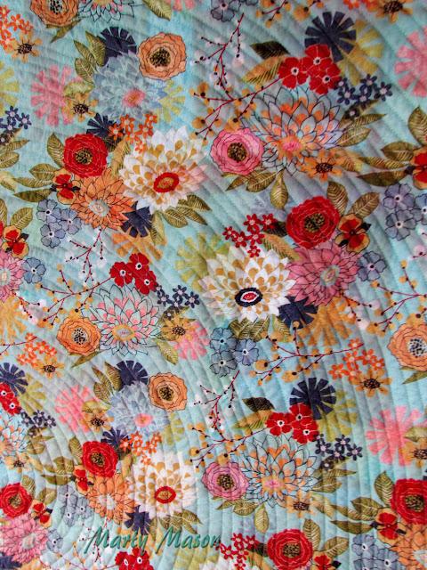 PB&J - BasicGrey quilt back showcasing spiral quilting by Marty Mason
