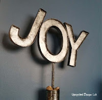 http://www.upcycleddesignlab.com/2015/12/upcycled-cardboard-faux-metal-letters-holiday-decoration.html
