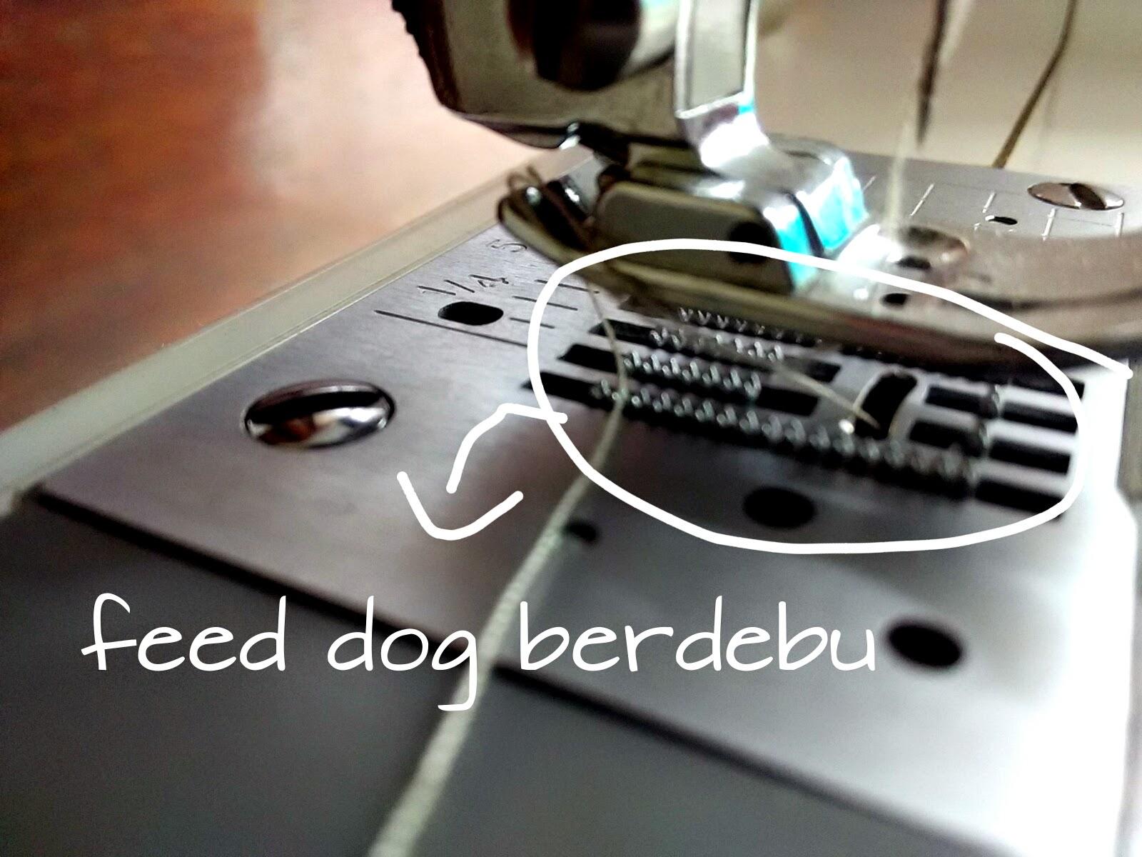 debu di feed dogs mesin jahit