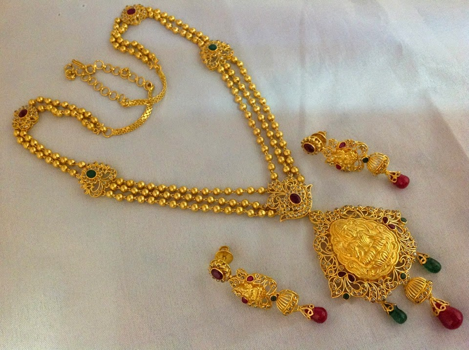 Jewellery Designs Gold Balls Haram with Lakshmi Devi pendent and
