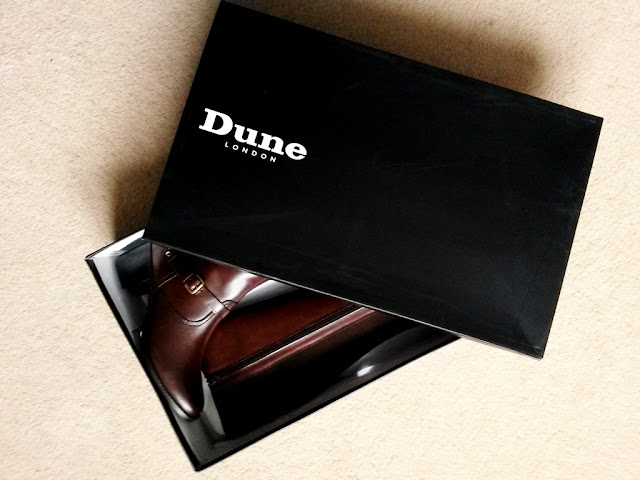 Dark brown leather long boots in Dune shoebox