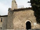 El mur de migdia amb el portal d'entrada de Sant Genís Sadevesa