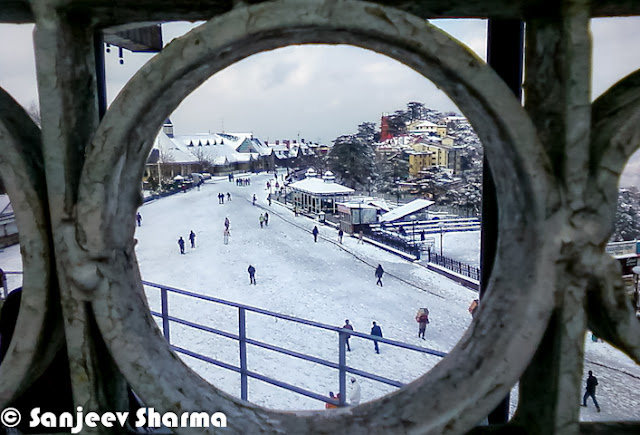 Shimla is enjoying the fresh snowfall on the hills and people have come out to celebrate in white Shimla. Let's check out these mobile clicks from Shimla by Mr Sanjeev Sharma (Senior Reporter, Zee).Here is a photograph of Shimla covered with snow layer and all white. Photograph has been clicked from one end of the mall road near Oberoi Hotel. Ridge Church looks amazing on top of the town and everything else covered with White layer of fresh snowfall.Shimla meteorological office director Manmohan Singh said, high hills of state would get heavy snowfall on Friday and moderate snowfall on Saturday. So many folks in Chandigarh & Delhi are supposed to come to Himachal to experience fresh snowfall during the weekend.A brilliantly clicked photograph of Sanjeev Sharma, which shows the view of Ridge ground in Shimla. There is a small place to overlook this whole ground and photograph is clicked from the same place. This elevated shed comes of the way from Ridge Ground to Jakhu Temple. A photograph of Shimla Club which is again situated on Mall Road. This is one of the great place to celebrate special occasions, although everyone is not allowed in Shimla Club.Hoteliers in Shimla & other places of Himachal Pradesh say snowfall would prove boon for tourism as visitors would throng Himachal to see the fresh snow. Many trourists visit Shimla during winters in a hope to see fresh snowfall happening. Traffic in these towns was partially affected in upper. There was minimal impact on main highways connecting Shimla & Manali to Chandigarh/Delhi.A view of Christ Church from mall road, just below it. This church is situated on the famous Ridge ground of Shimla.Ridge ground view after fresh snowfall in Shimla. Although there are some footsteps on the snow, which shows that many shimlites have already had a round on ridge ground to enjoy in first snowfall of 2013.Upper reaches of Himachal Pradesh received snowfall on Thursday much to the delight of tourists and residents, who had been ex