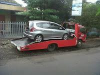kirim mobil dari kota malang ke bekasi