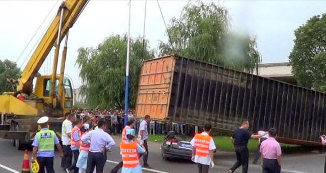 Woman Miraculously Survives After Container Falls onto Her Car