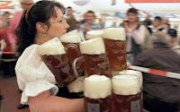 German bar maid carries 21 steins pitchers of beer