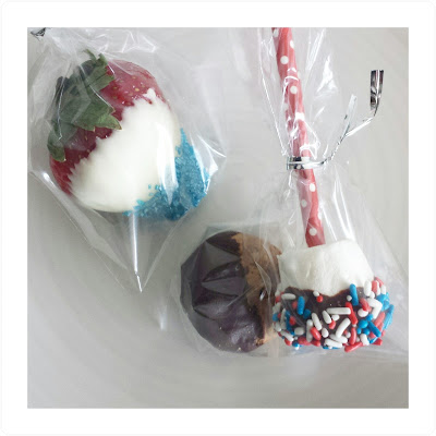 Red white and blue strawberry poppers and marshmallows