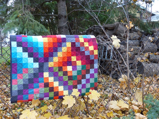 Folded Carsick quilt on fence