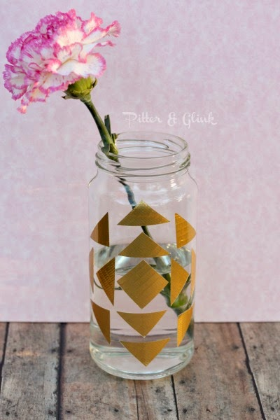 Create a trendy geometric print vase using a recycled glass jar and Duck tape! PitterandGlink.com