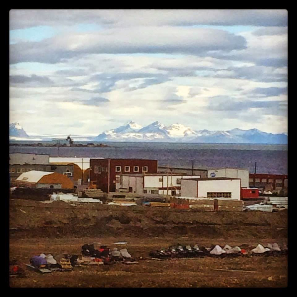 Radisson Hotel Room View Svalbard snowy mountains and logged house