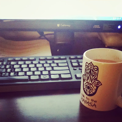 hamsa coffee mug keyboard office workstation break time