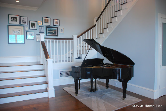 baby grand piano in the entry