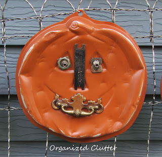 Repurposed Cake Pan Jack o'Lantern www.organizedclutterqueen.blogspot.com