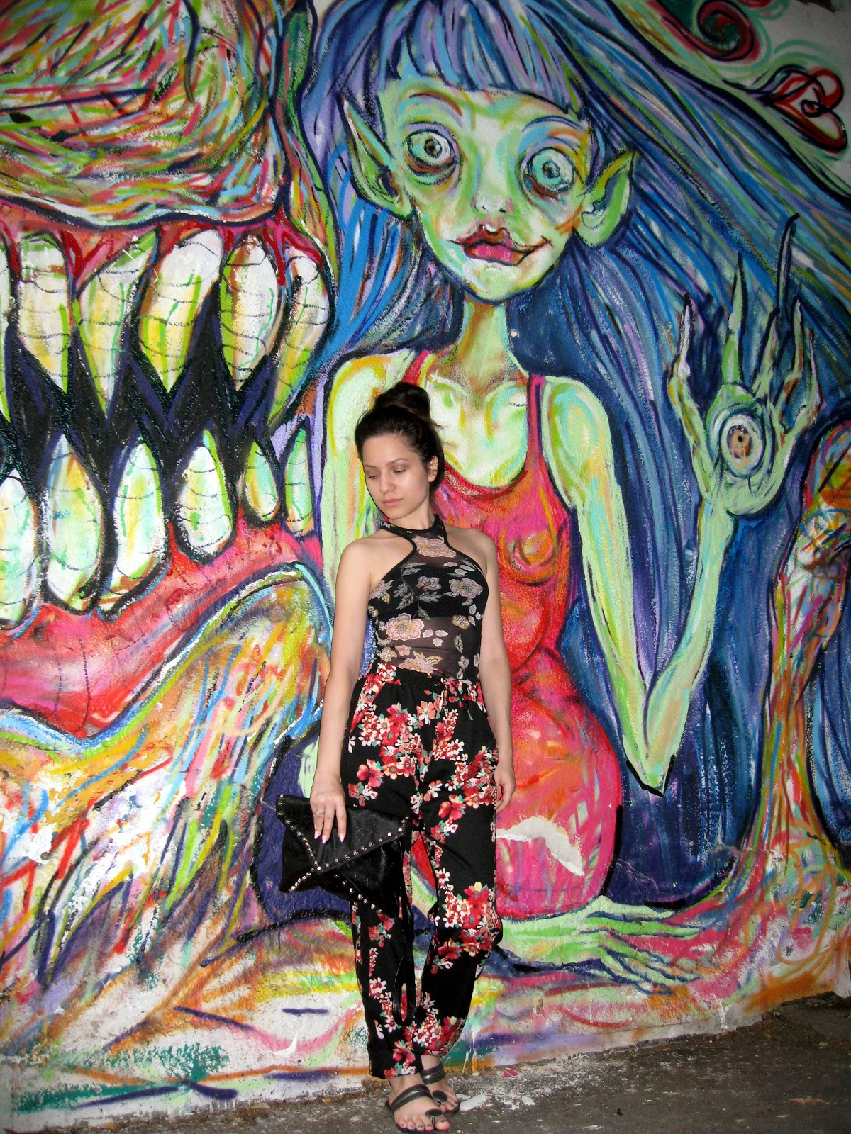 terranova sheer floral tank top, terranova floral pants, black flip flops, black studded clutch, messy bun, casual look, street graffiti art
