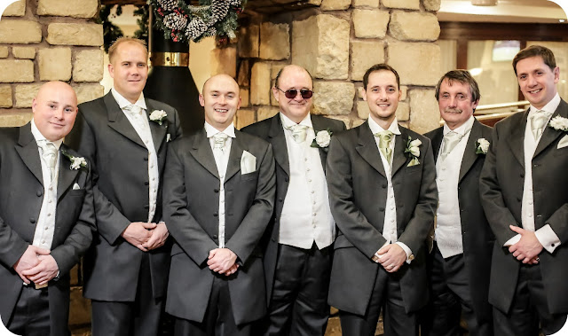 Ushers and groom at Wedding with pale green ties