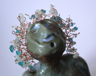 clay mermaid with copper hair and sea glass closeup