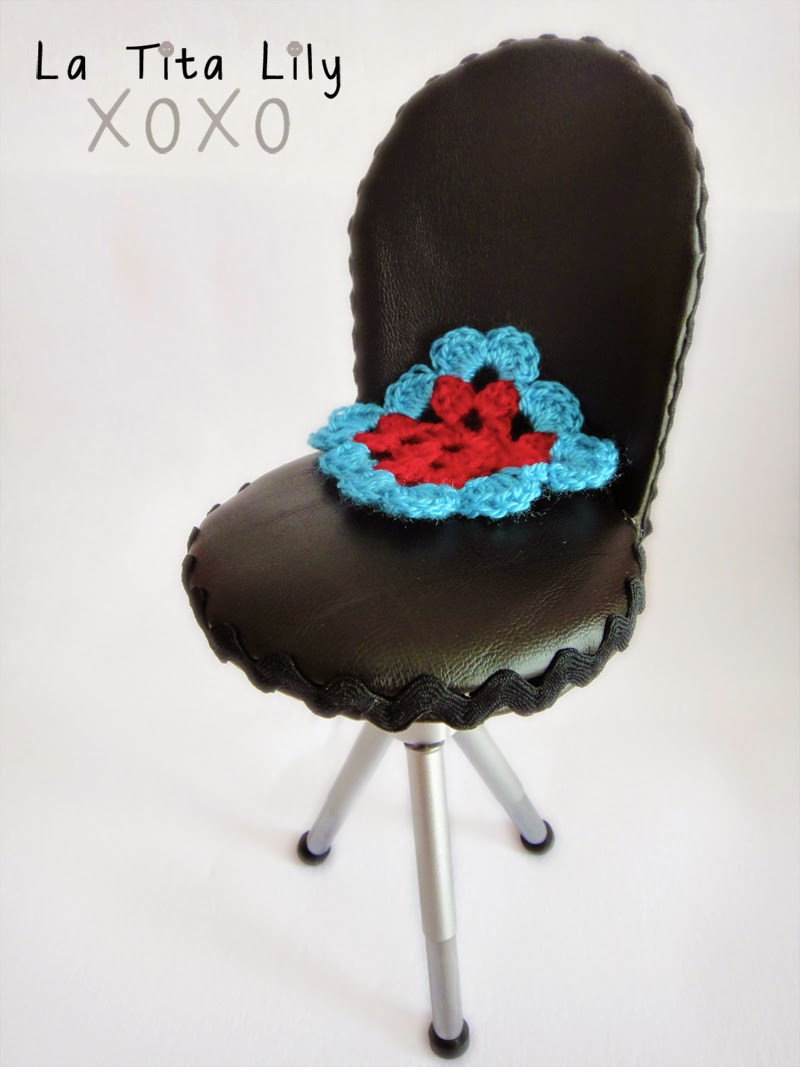 Doll chair made with a mini tripod.