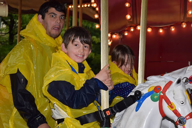 smiles and funny faces on the carousel at legoland
