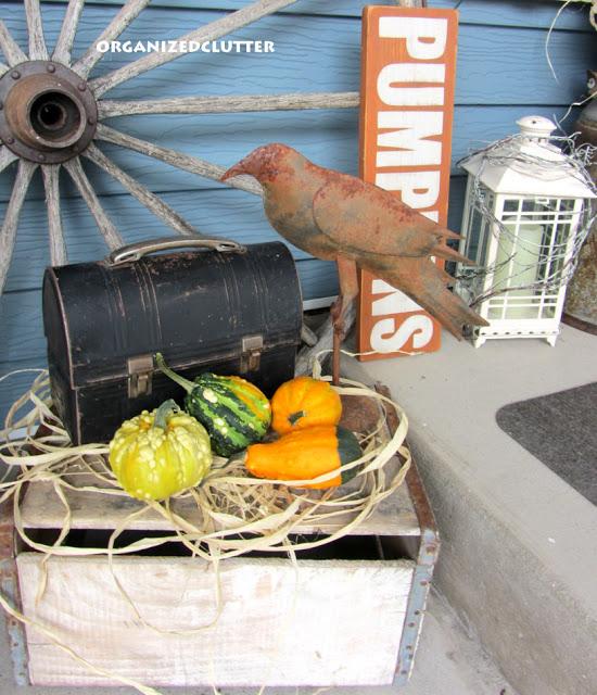 Fall Outdoor Vignette with Garden Wheel Backdrop