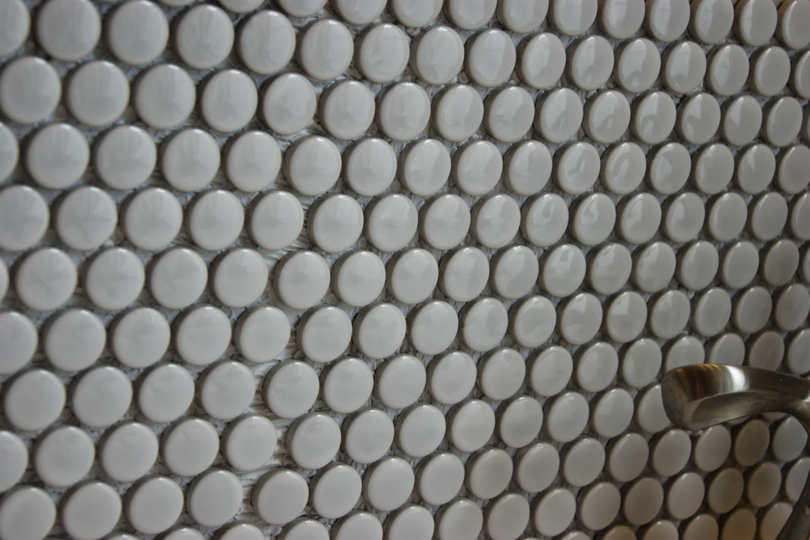 a for penny tile sanded grout we chose a darker grout and i am so glad that we did it made the tile look