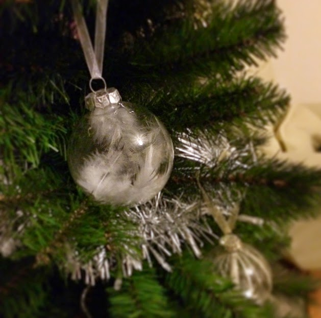 Feathery baubles look so pretty on the tree omg