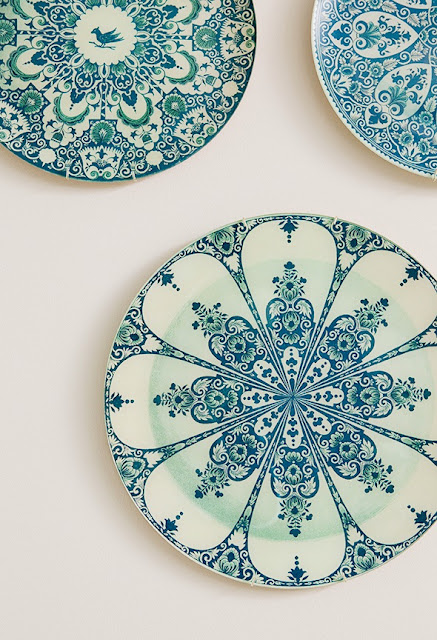 Blue and white plates being used as wall decor