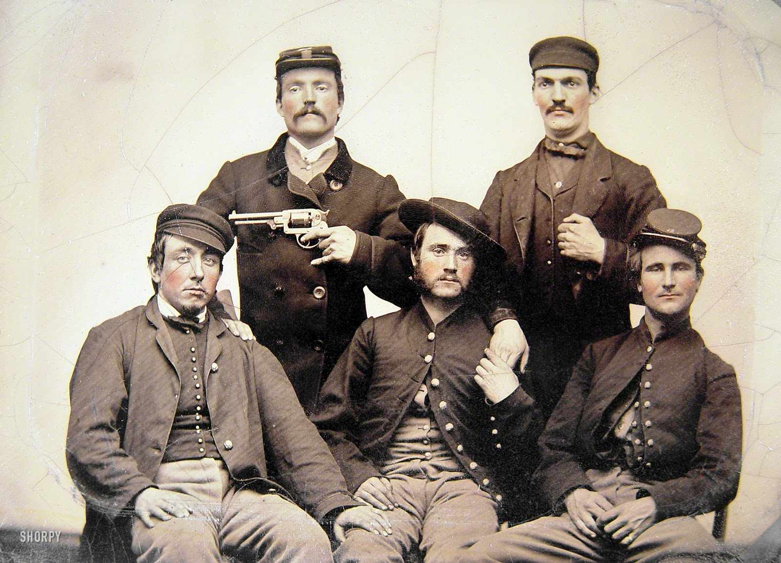 unidentified men in union uniforms one pointing a revolver at anothers head half plate tintype hand colored liljenquist family collection of civil war