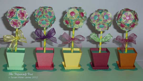 The papercraft post topiary trees to make it punched paper flowers are glued on to a paper ball the flowers are made using tonic studios petal pairs punches both the original size and mightylinksfo