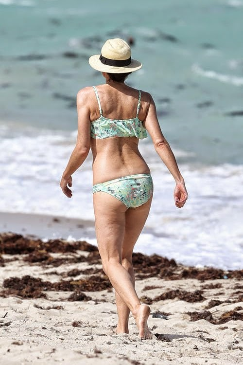 Minnie Driver sizzles in an Aquamarine Bikini as she walks by herself in Miami