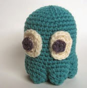 http://www.ravelry.com/patterns/library/amigurumi-pacman-ghost