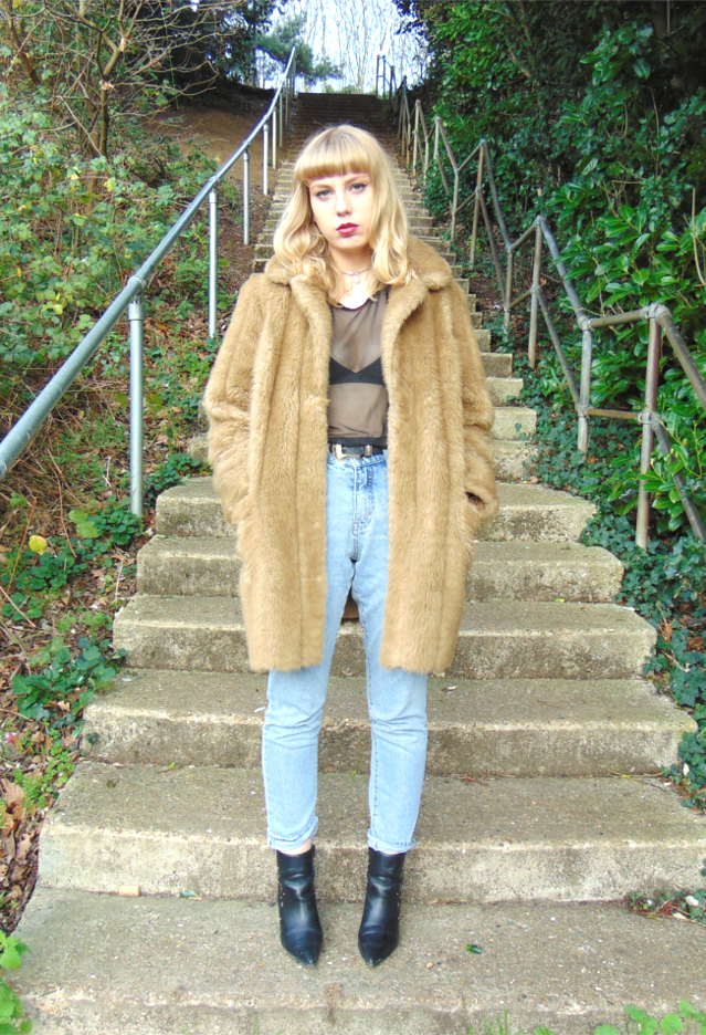 cheap monday urban outfitters girlfriend jeans, asos el paso boots, star studded pointed boots, mesh t-shirt, calvin klein bra, camel tan faux fur coat, alternative fashion style ootd outfit
