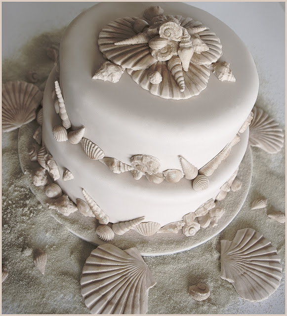 This fabulous Beach Wedding Cake is covered in ivory sugarpaste and