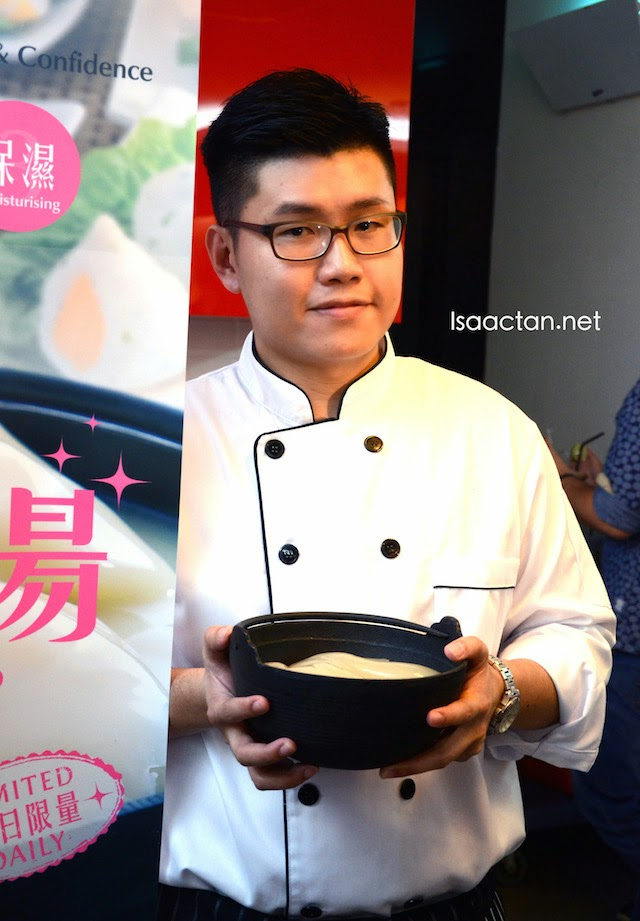 The chef and owner posing with Bone & Pot's signature Collagen Soup