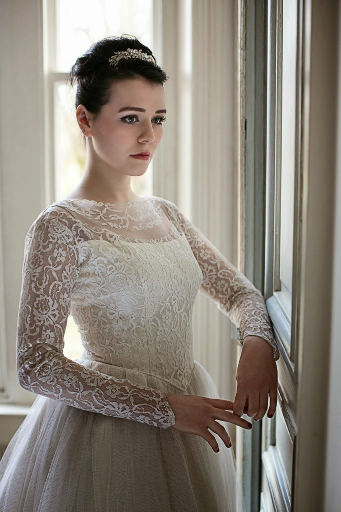 Long lace sleeves, and neat fitted lace bodice