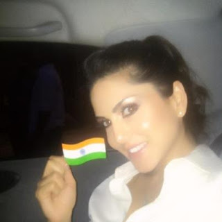 Sunny Leone Photos showing an Indian Flag in her Car