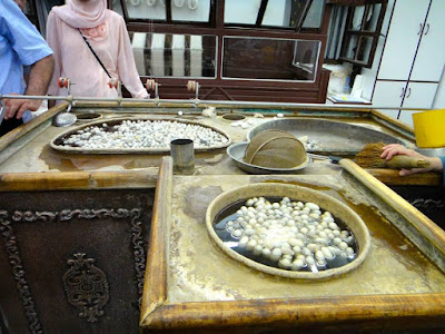 Boiling silk cocoons for carpet in Turkey
