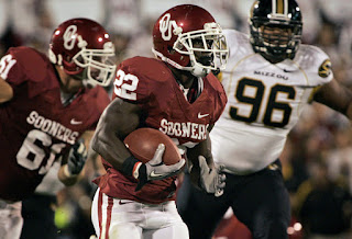 Running back Roy Finch #22 of the Oklahoma Sooners rushes up field during the first half against the Missouri Tigers on September 24, 2011 at Gaylord Family-Oklahoma Memorial Stadium in Norman, Oklahoma. Oklahoma leads Missouri 24-14 at the half. (September 23, 2011 - Source: Brett Deering/Getty Images North America)