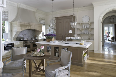 the kitchen is also furnished in white and light hues in simple and elegance style