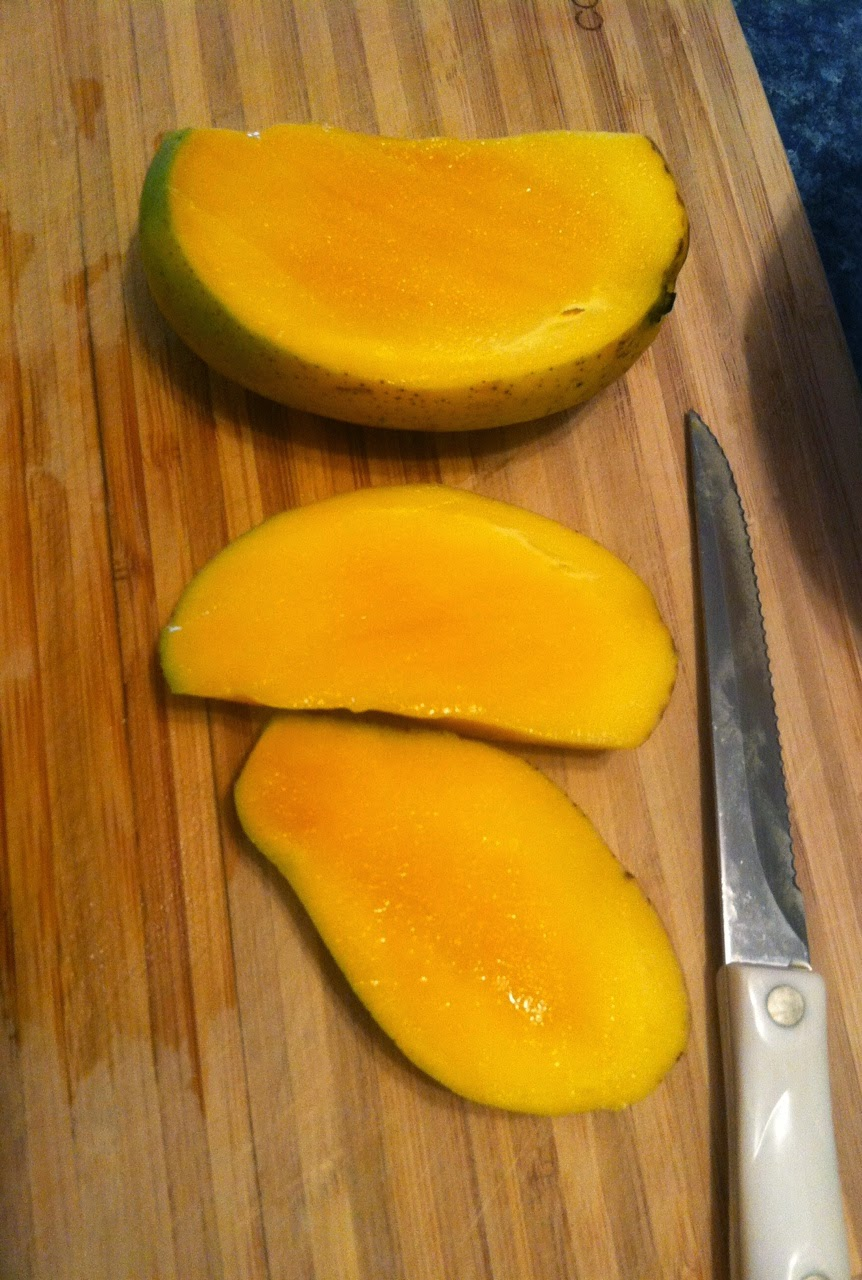 slicing mango for salsa. Easy Cooking Chat recipe.