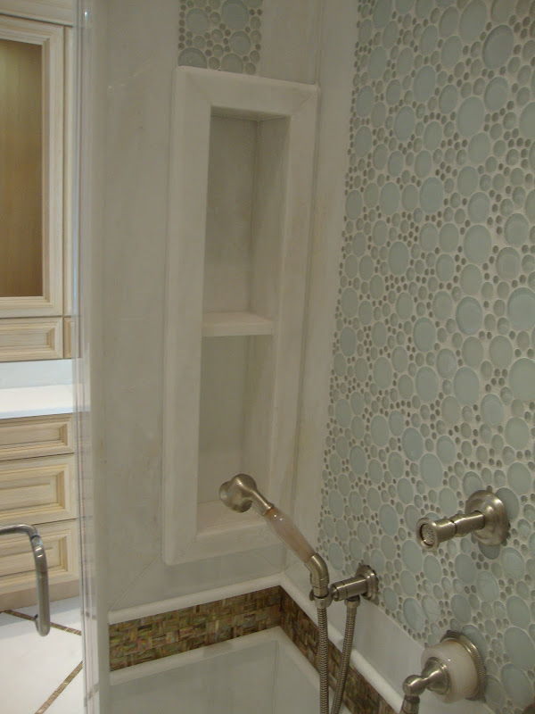 Guest Bathroom in Green Forest Slabs and Oolitic Limestone Mosaic title=