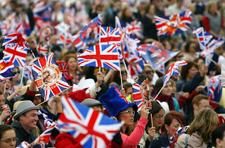 Spectators wave their flags in Hyde Park where big screens have been set up to watch the wedding ceremony in London
