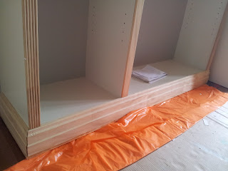 My Decor Education_ikea billy boookcase hack during with wood trim