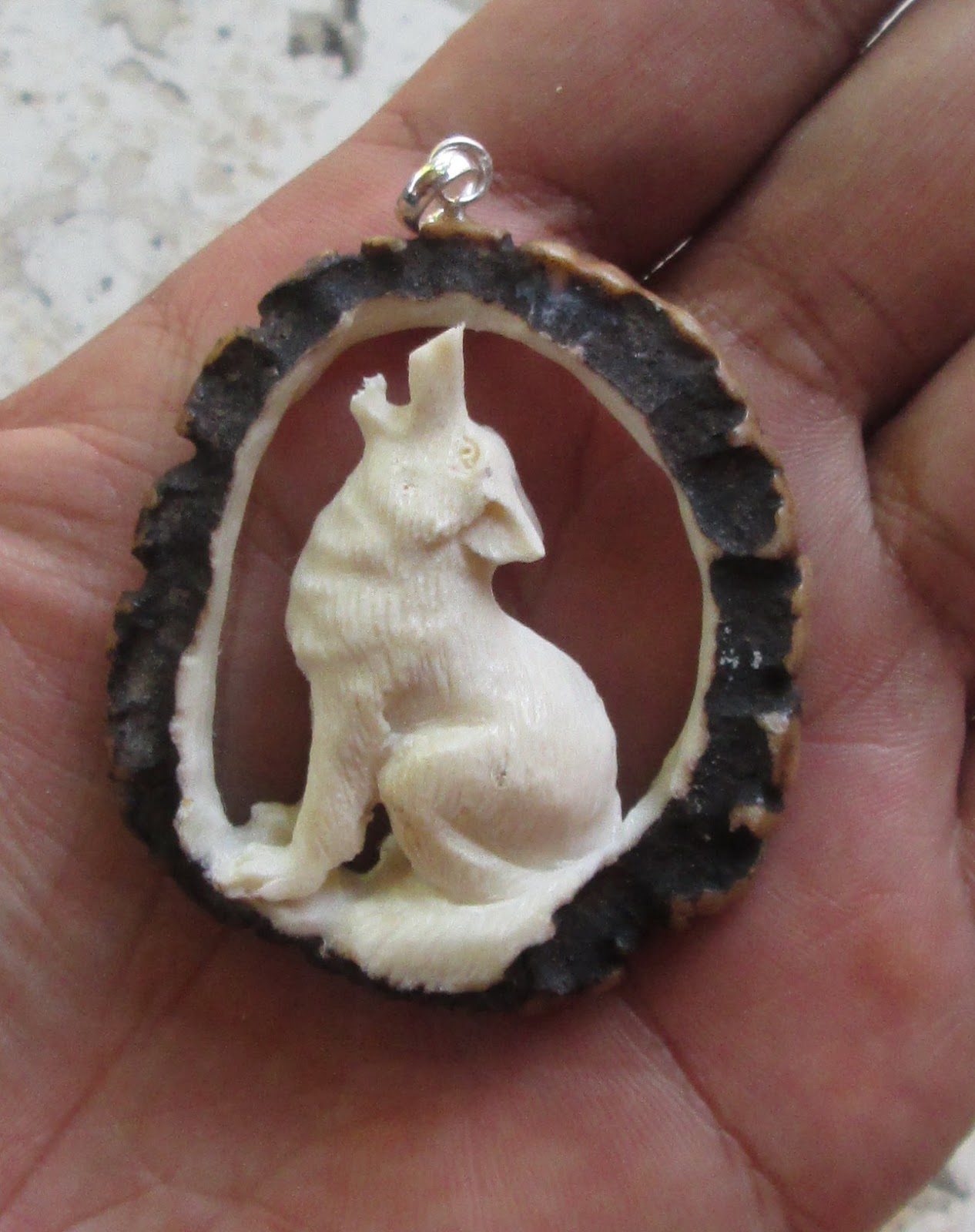 Howling Wolf Carved Bone Pendant