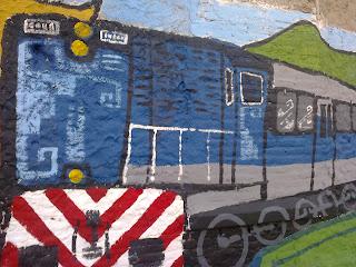 Tren. Arte en la calle. Mural. El viaje imposible. Fugas y obsesiones