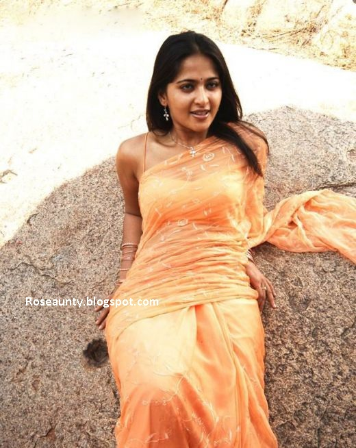 Anushka Shetty in wet saree showing navel