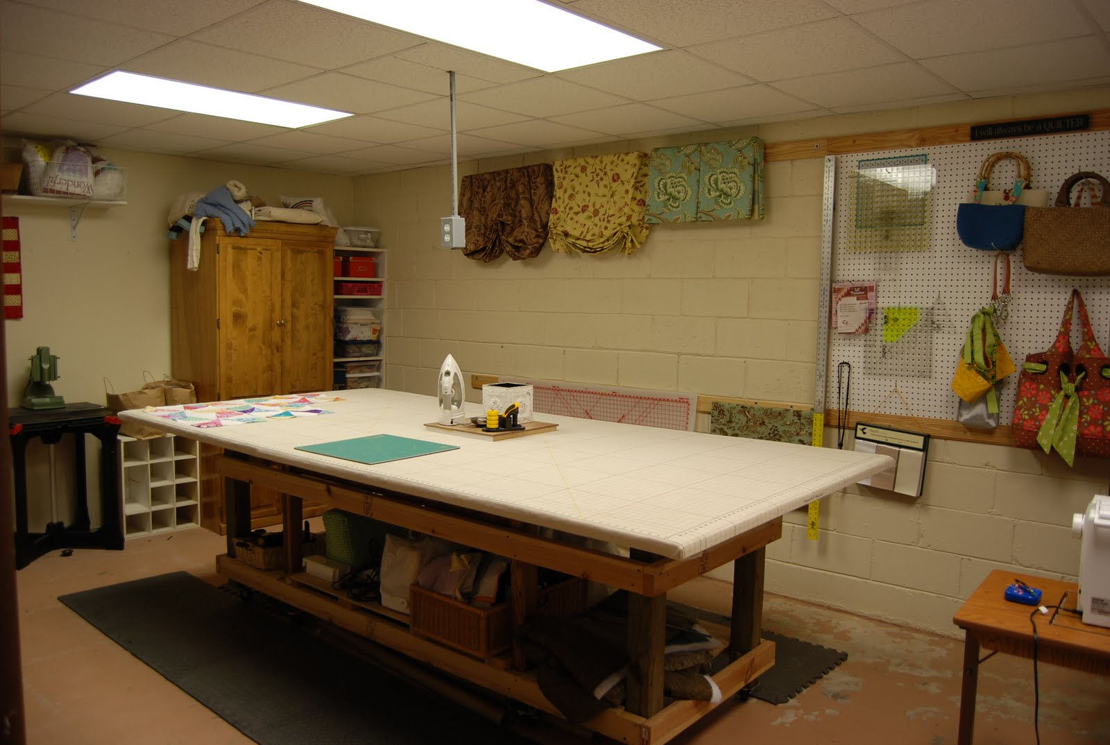 Spin the bobbin my sewing studio this is my awesome cutting table that my husband made besides quilting i make custom window treatments for friends family and occasionally clients watchthetrailerfo